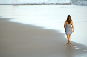 Women travelling individually on beach